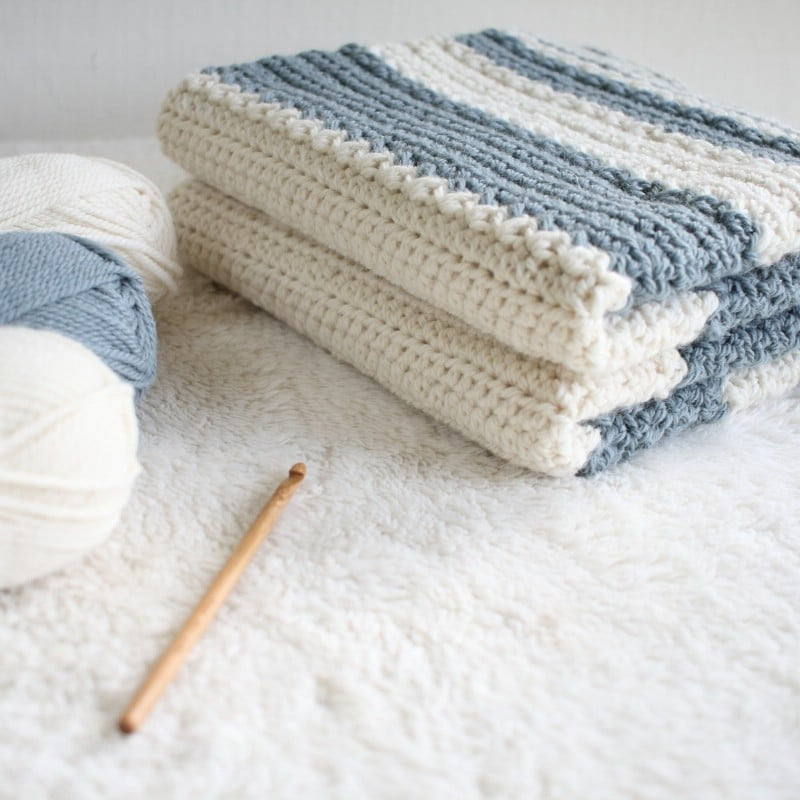 Yarn used for the baby blanket and the finished blanket next to it.