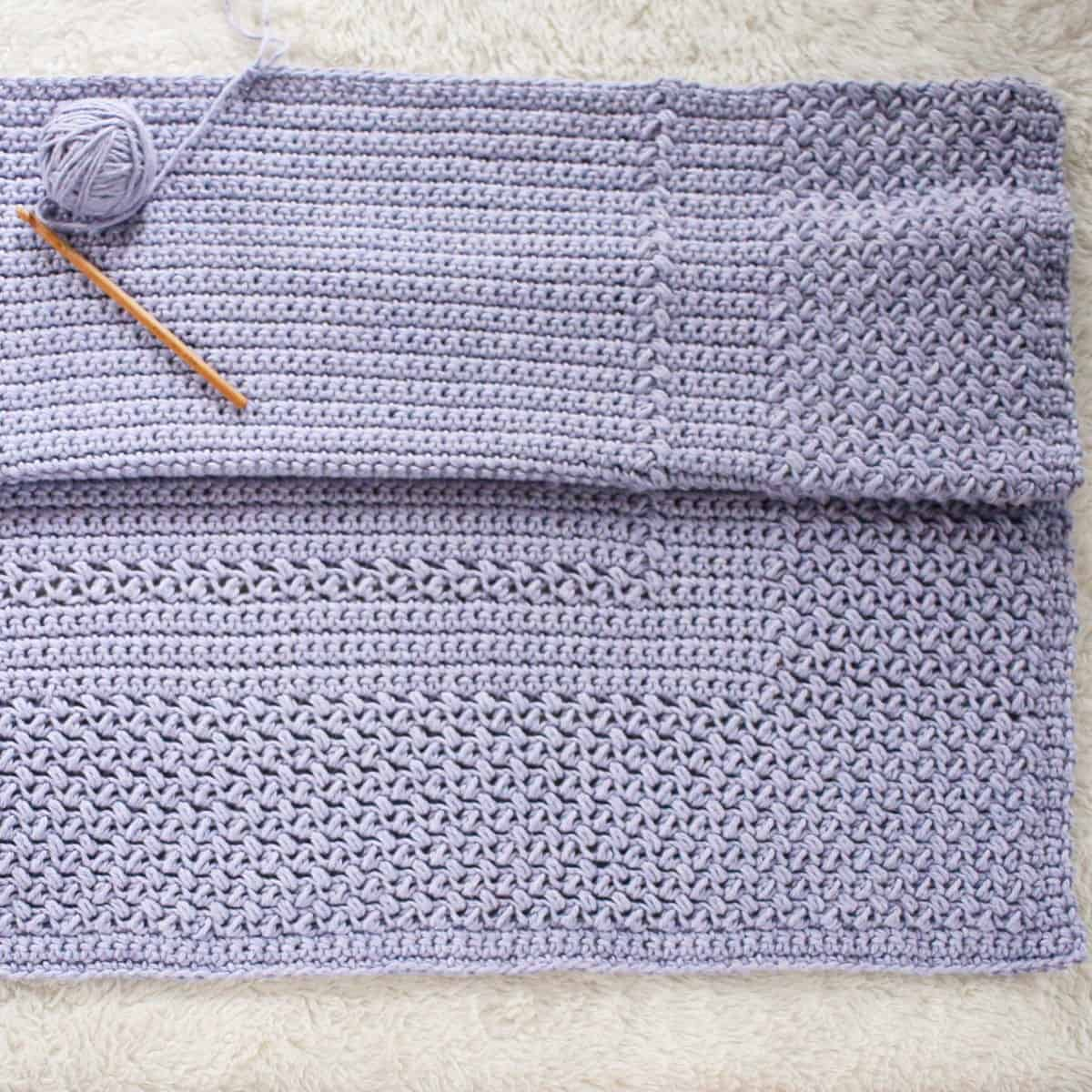 Crochet the Story Book Blanket with just 2 easy stitches.